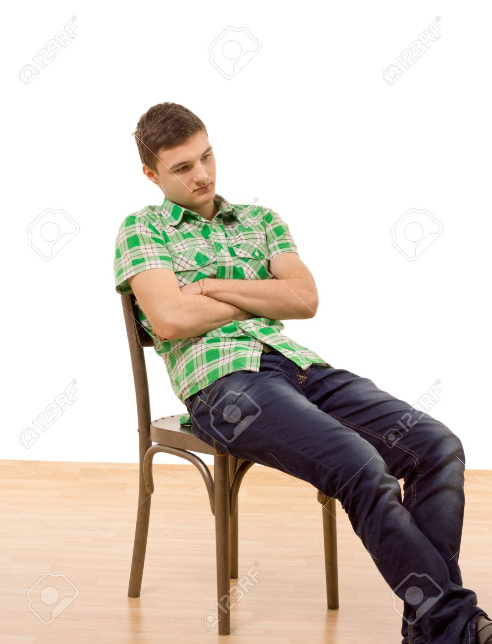 Handsome Young Man Sitting Slumped In A Wooden Chair With His Stock Photo Picture And Royalty Free Image Image 26307960