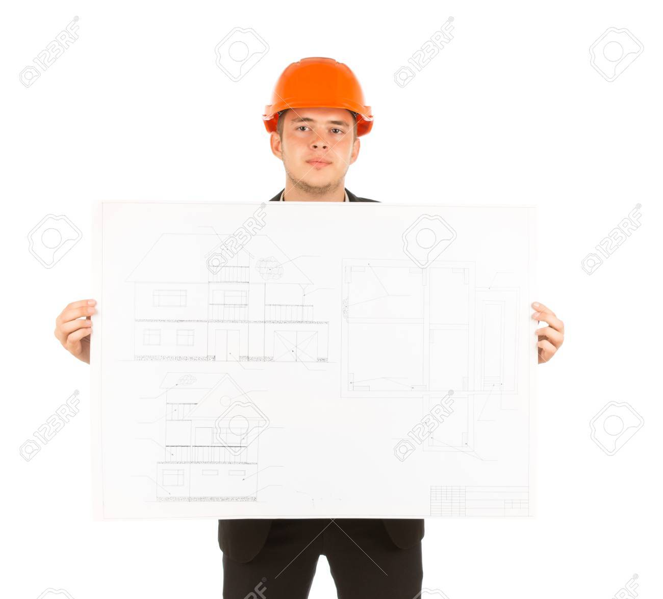 Close up young male engineer in orange head protector showing close up young male engineer in orange head protector showing building blueprint design while looking at malvernweather Choice Image