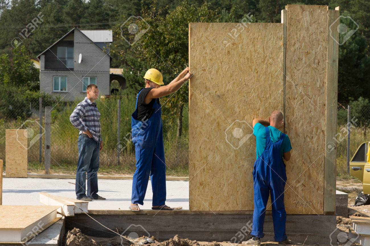 Team Of Young Builders Erecting Prefabricated Wall Panels On Stock Photo Picture And Royalty Free Image Image 32953700