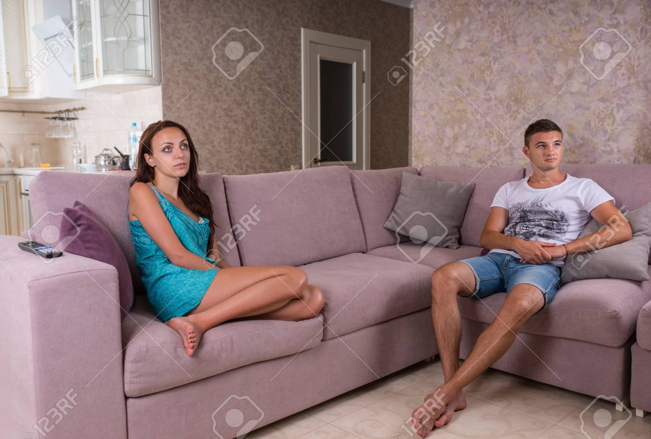 Magnificent Young Couple Sitting Apart On Sectional Sofa And Watching Television Creativecarmelina Interior Chair Design Creativecarmelinacom