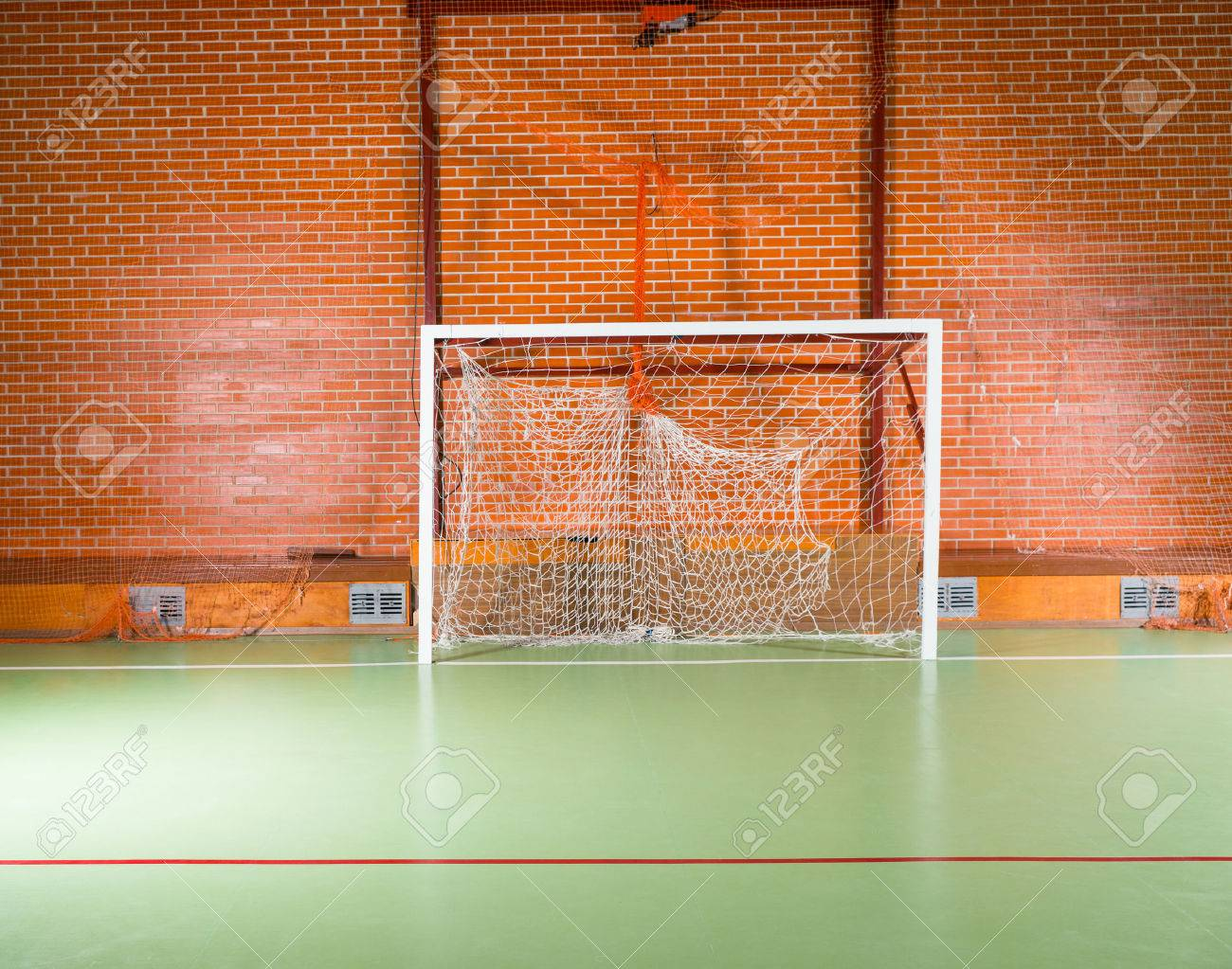 Empty Goal Posts On An Indoor Court Or Playing Field For Soccer ...