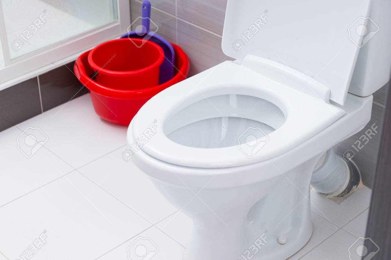 Close Up On Open Toilet In Clean Bathroom With White And Gray ...