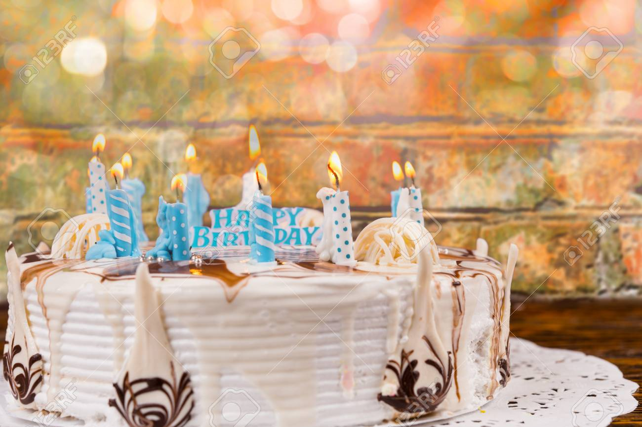 Homemade Birthday Cake With Lots Of Just Extinguished Candles