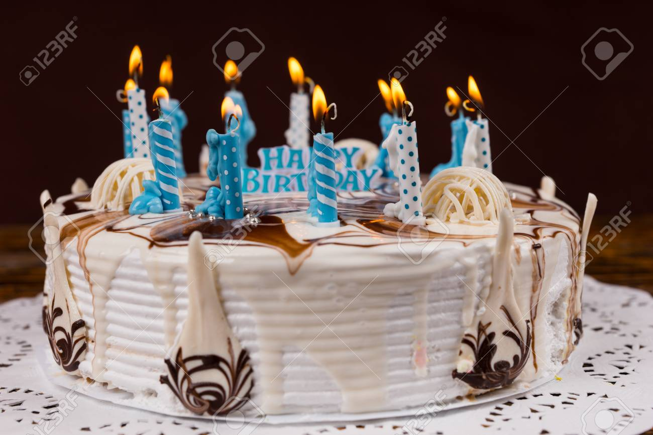 Homemade Birthday Cake With Lots Of Blue Burning Candles Near