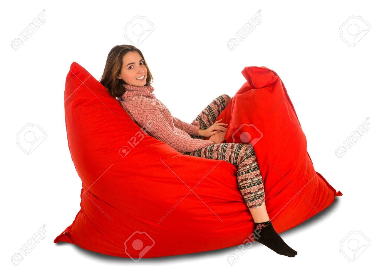 Cute Young Woman Sitting On Red Beanbag Sofa Chair For Living Room Or Other  Room Isolated
