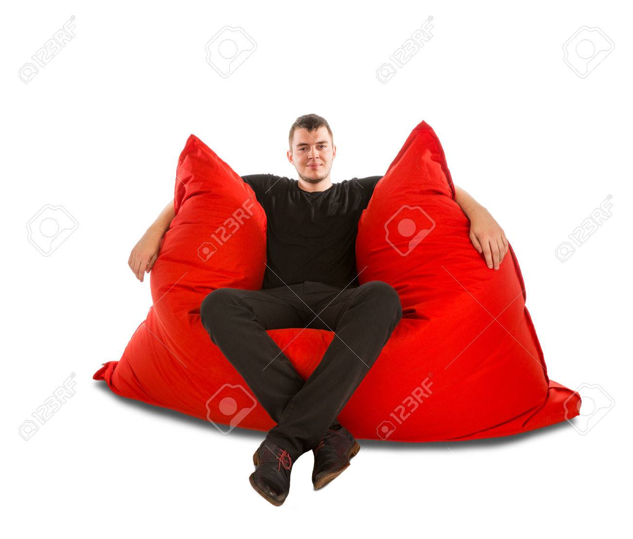 Groovy Young Man Sitting On Big Red Beanbag Sofa Chair For Living Room Cjindustries Chair Design For Home Cjindustriesco
