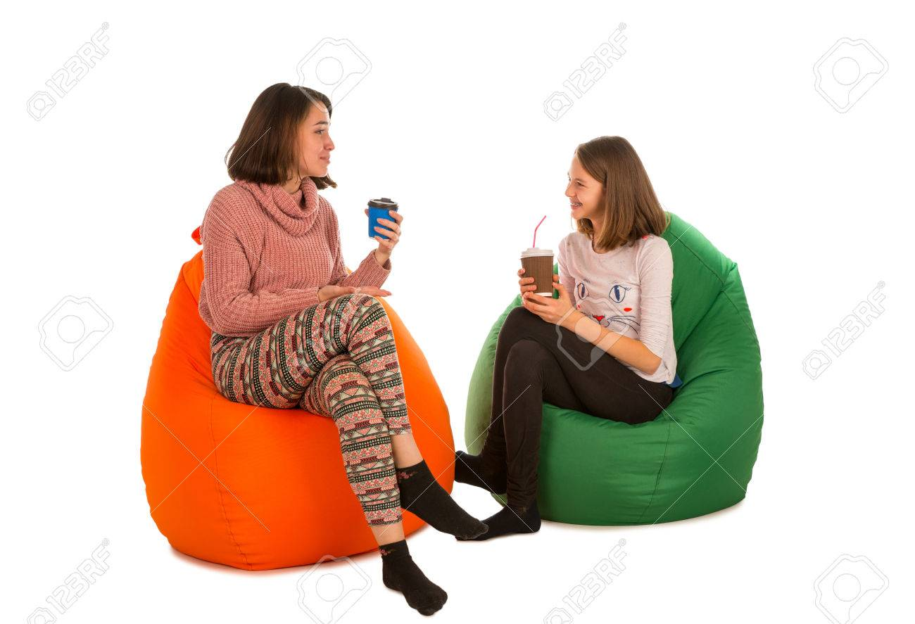 bean bag pillow young woman and a girl sitting on beanbag chairs and drinking coffee