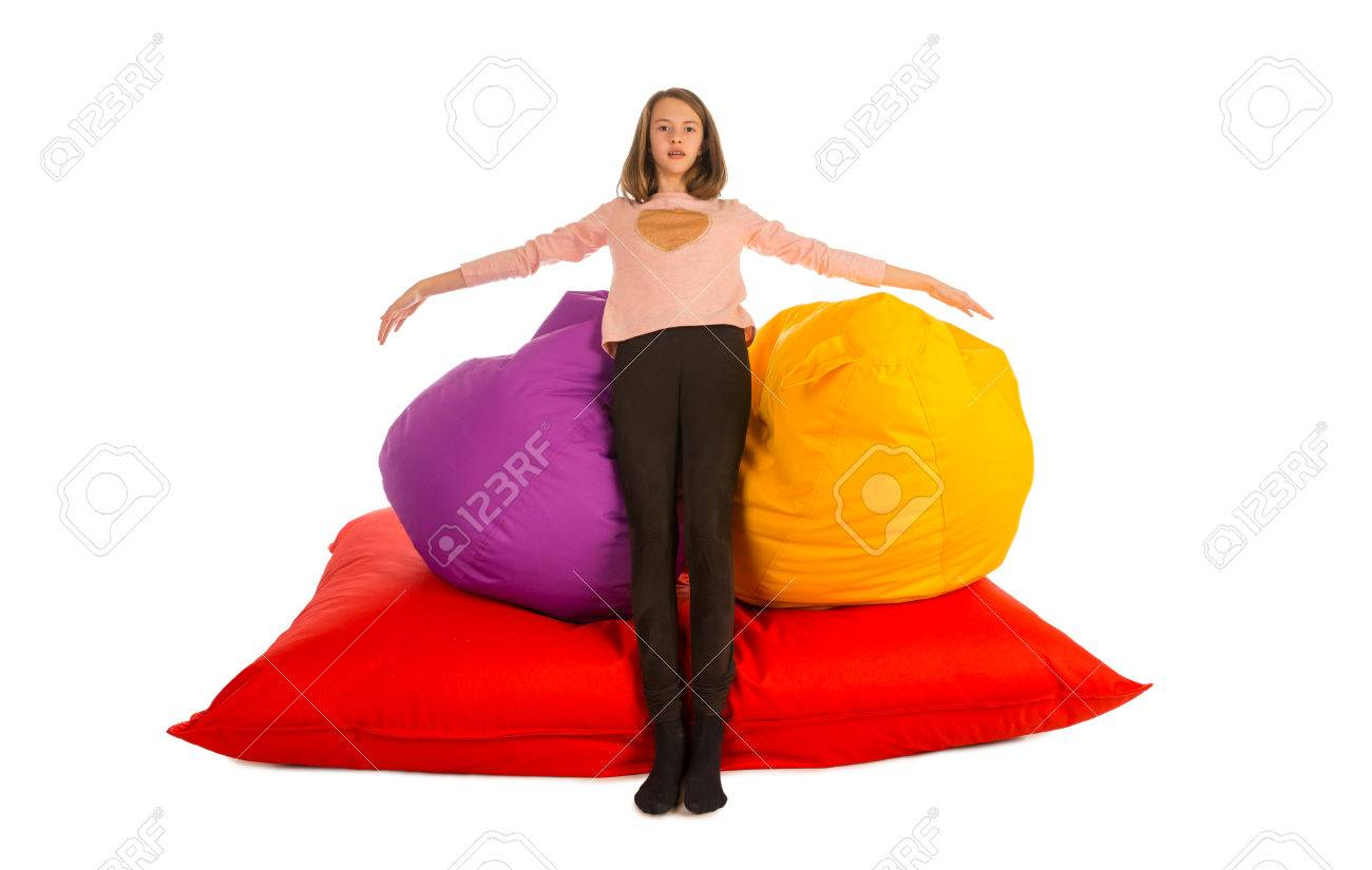 Astounding Girl Standing Near Beanbag Chairs And Beanbag Sofa Isolated On Ocoug Best Dining Table And Chair Ideas Images Ocougorg