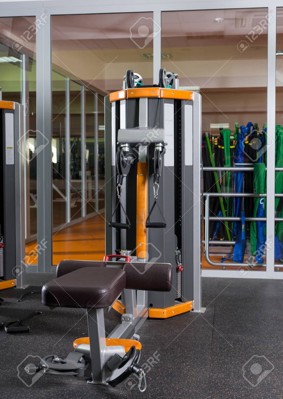 Fitness equipment and machines at the empty modern gym room in