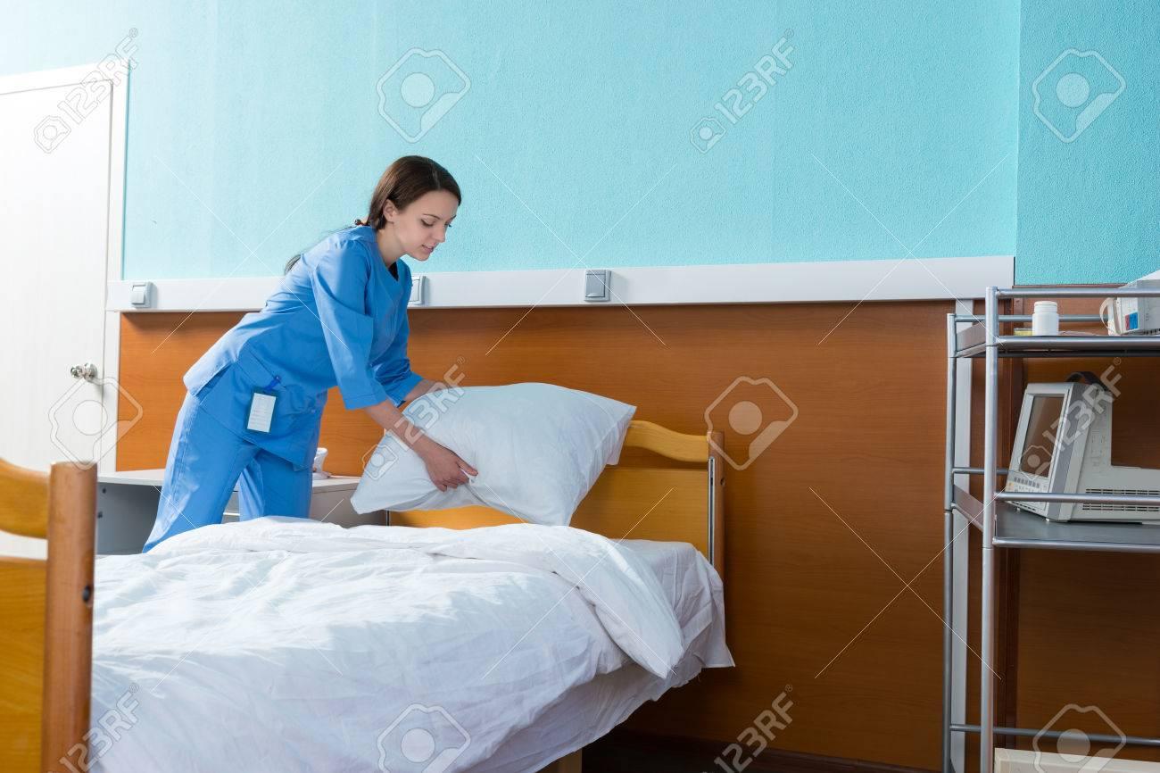 Female nurse holds a white pillow over the hospital bed in the hospital ward the & Female Nurse Holds A White Pillow Over The Hospital Bed In The ... pezcame.com