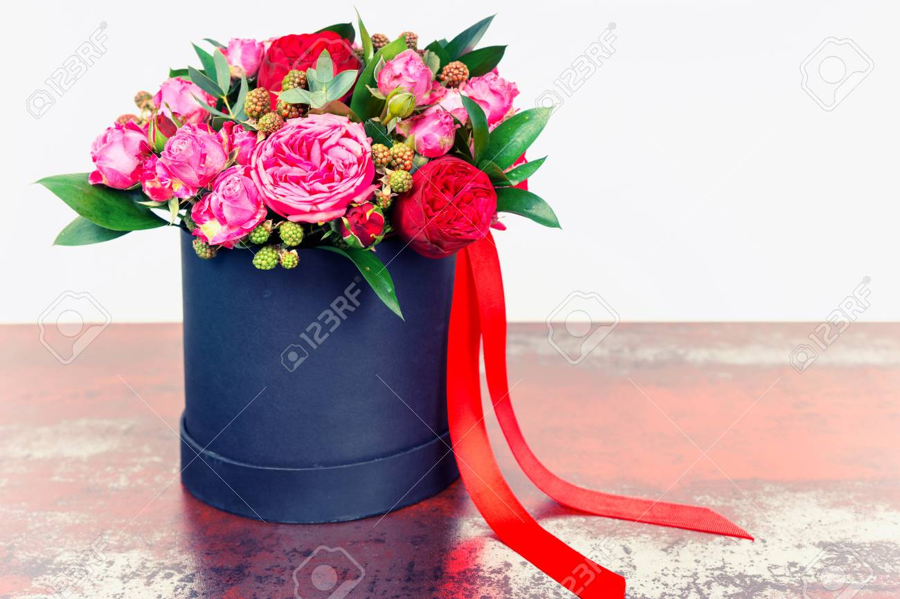 Beautiful bouquet of pink roses and red ribbon in a concept of beautiful bouquet of pink roses and red ribbon in a concept of love romance izmirmasajfo