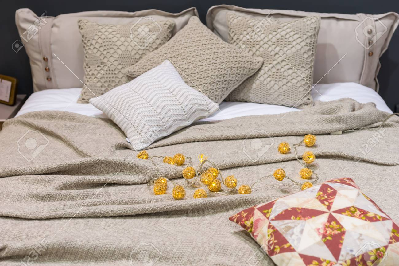 Cozy Bed Linen With Decorative Pillows In Bedroom In Staging Stock Photo Picture And Royalty Free Image Image 96918031