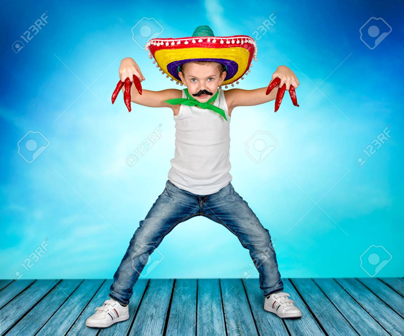 1c40992b9a8d6 Funny boy with a fake mustache and in the Mexican sombrero. Stock Photo -  92817454