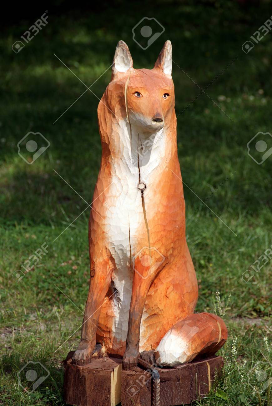 Wooden sculpture of an animal on a background of a forest Stock Photo - 9992212