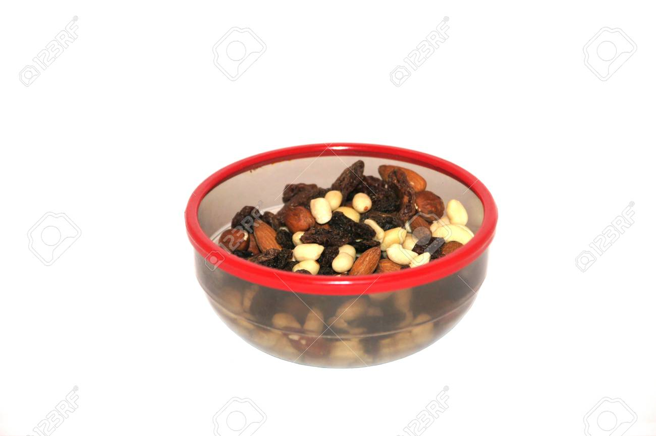 Nuts and raisin in a plate on a white background Stock Photo - 17693778