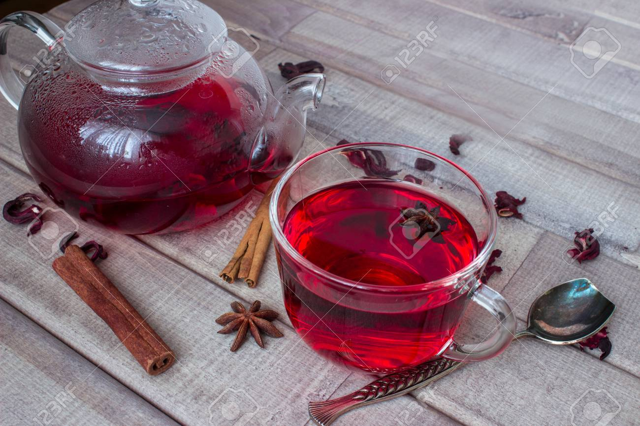 Hibiscus Tea In Glass Teapot Cap With Tea Spices And Dry Flower