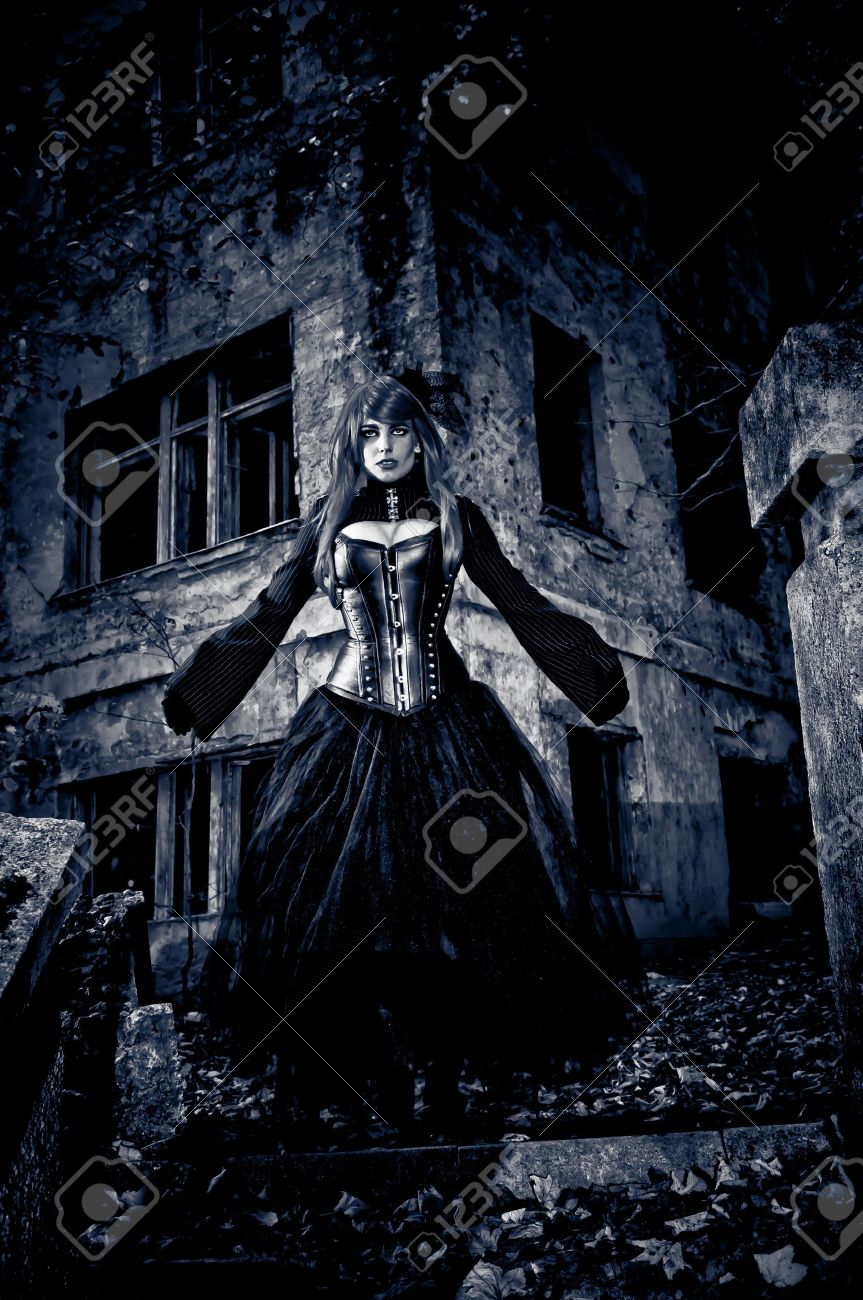 woman in black dress from nightmare or fantasy stock photo, picture