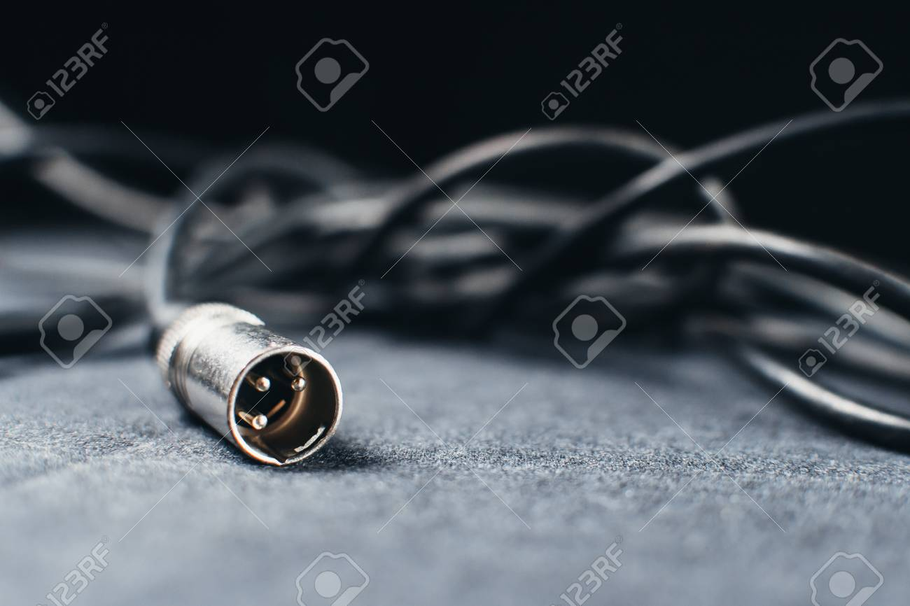 """XLR, connector with wires on a dark fabric background in the.. on electrical connector, speakon connector, trs connector, din connector wiring, xlr to stereo, banana connector, tip ring sleeve wiring, xlr female, xlr mic, headset connector wiring, 1 4"""" plug wiring, din connector, serial digital interface, trs connector wiring, vga connector wiring, mini-din connector, rca connector, audio and video connector, rca connector wiring, audio and video interfaces and connectors, dc connector, mini connector wiring, bnc connector, balanced audio, usb connector wiring, xlr jack pinout, 5 pin dmx wiring, speaker terminal, iec connector wiring, xlr microphone adapter, midi connector wiring, speaker connector wiring, microphone connector wiring, xlr pins, fahnestock clip,"""