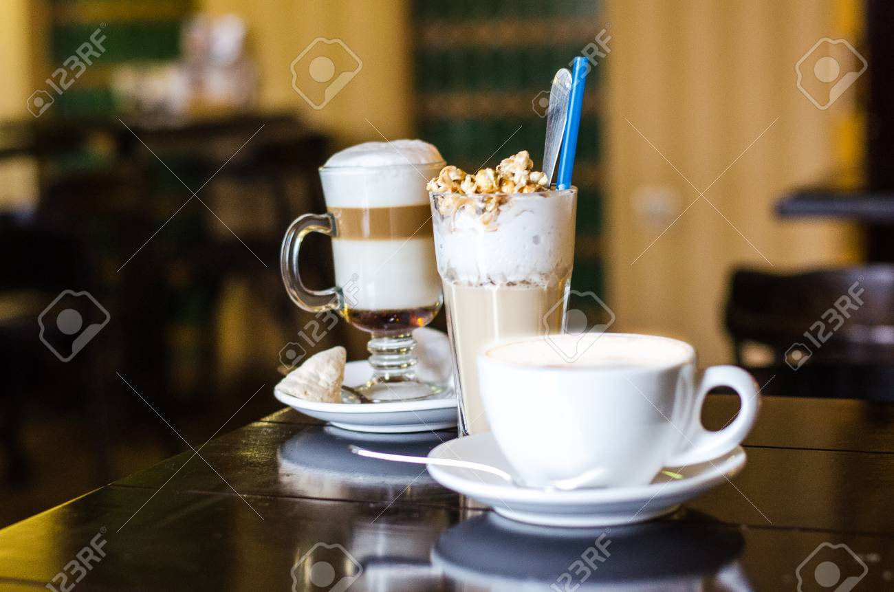 Stock Photo   Three Different Coffee Cups And On Darck Caffee Background.  Cappuccino, Latte And Frappe On Table. Coffee Shop With Cups Of Different  Coffee ...