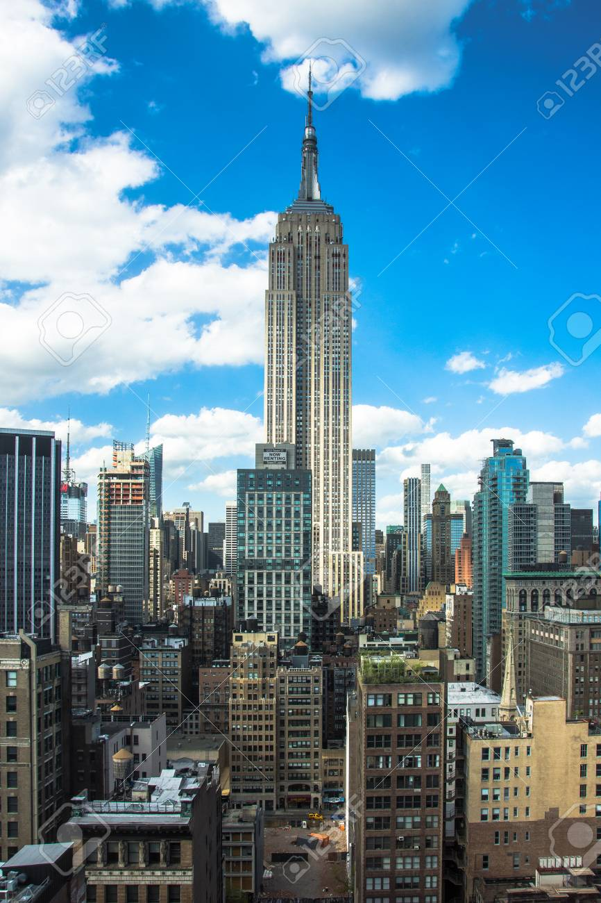 New York City. Manhattan downtown skyline with illuminated Empire State Building and skyscrapers at sunset. Aerial view of New York - 89708342