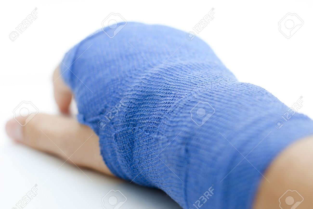 bandaged broken hand on white background and shallow depth of field Stock Photo - 12862039