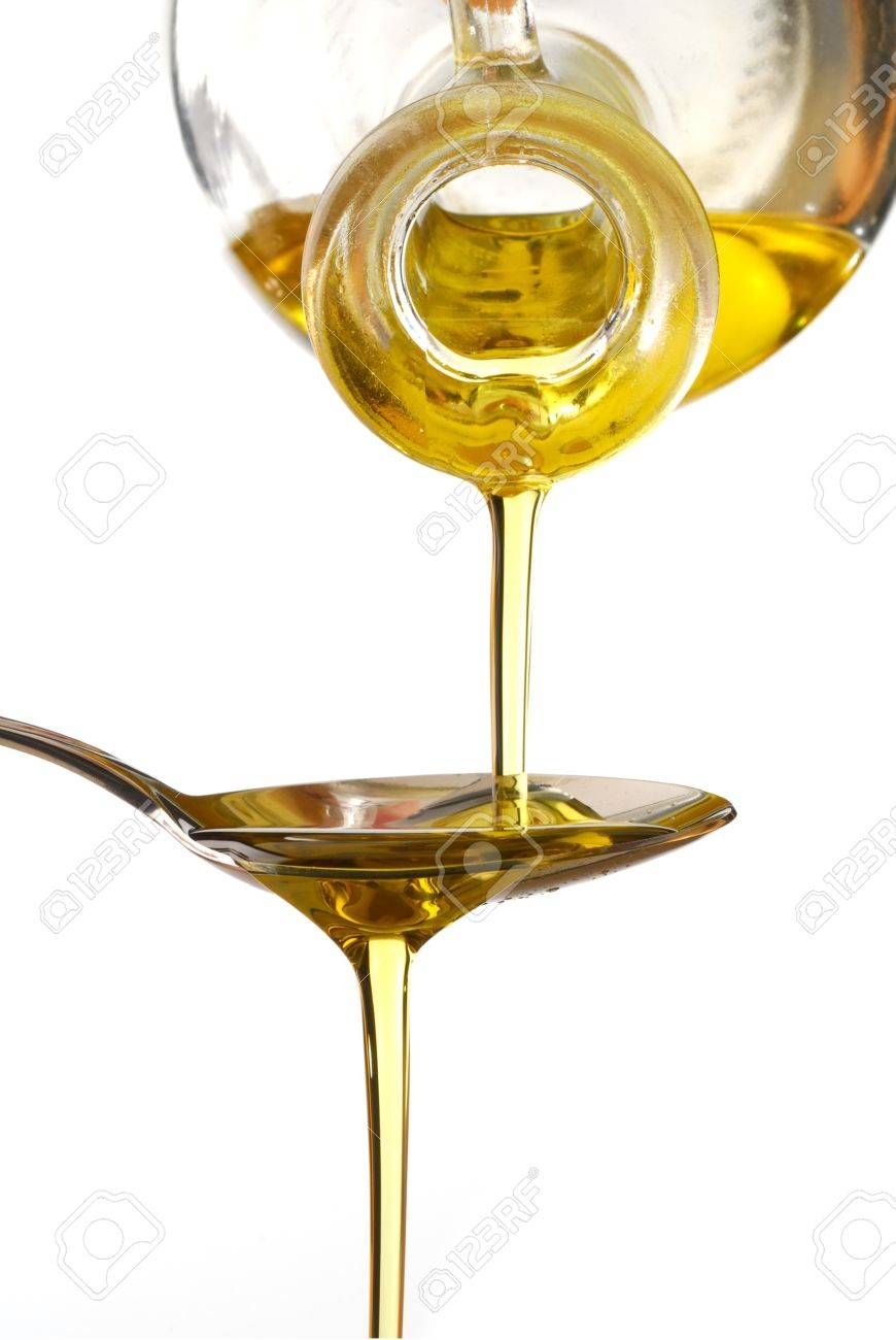 Olive oil poured into a spoon isolated on white background Stock Photo - 4304064