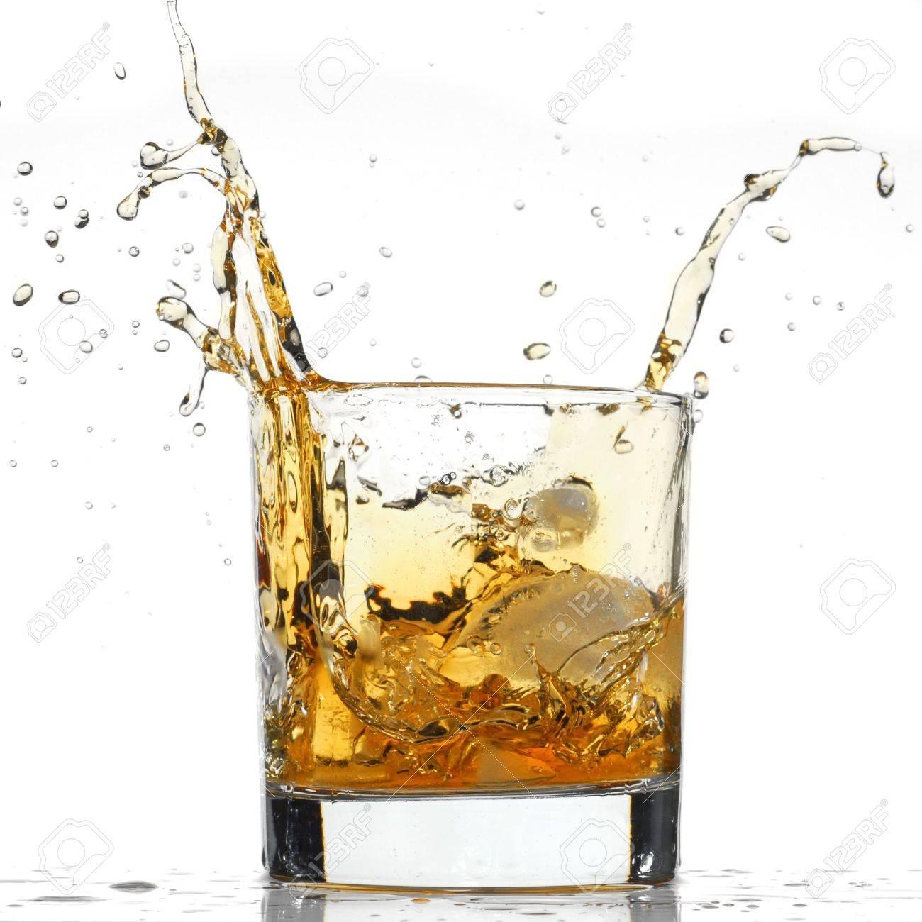 Whiskey splash studio isolated on white background Stock Photo - 4514303