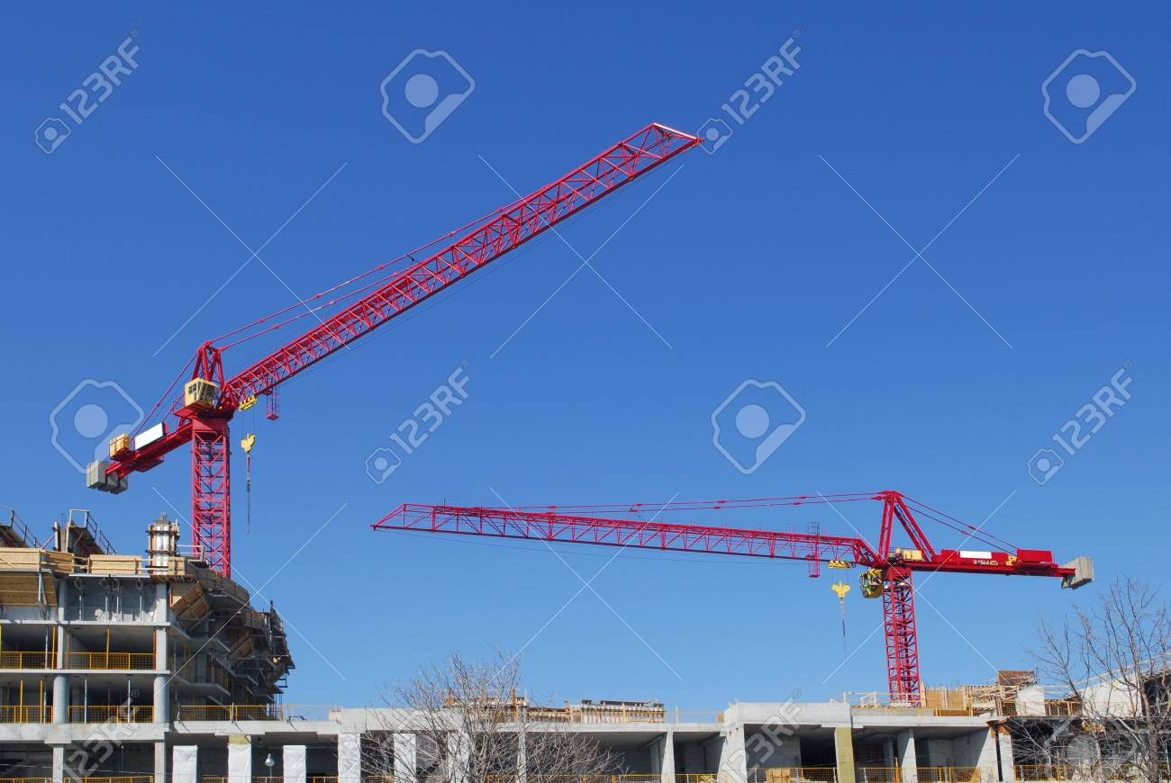 Construction work site with two cranes and blue sky Stock Photo - 4776311