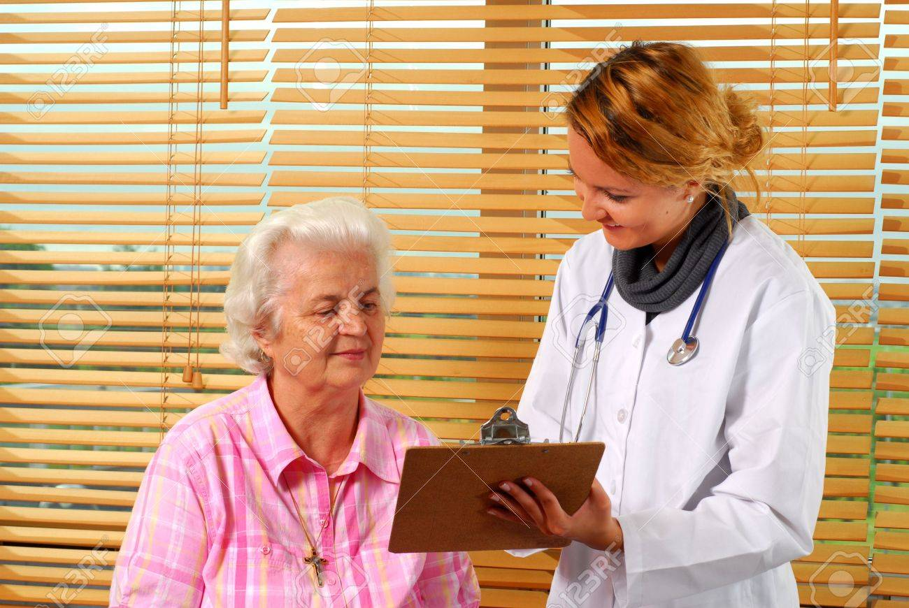 A young doctor talks to a patient during his visit Stock Photo - 5595147