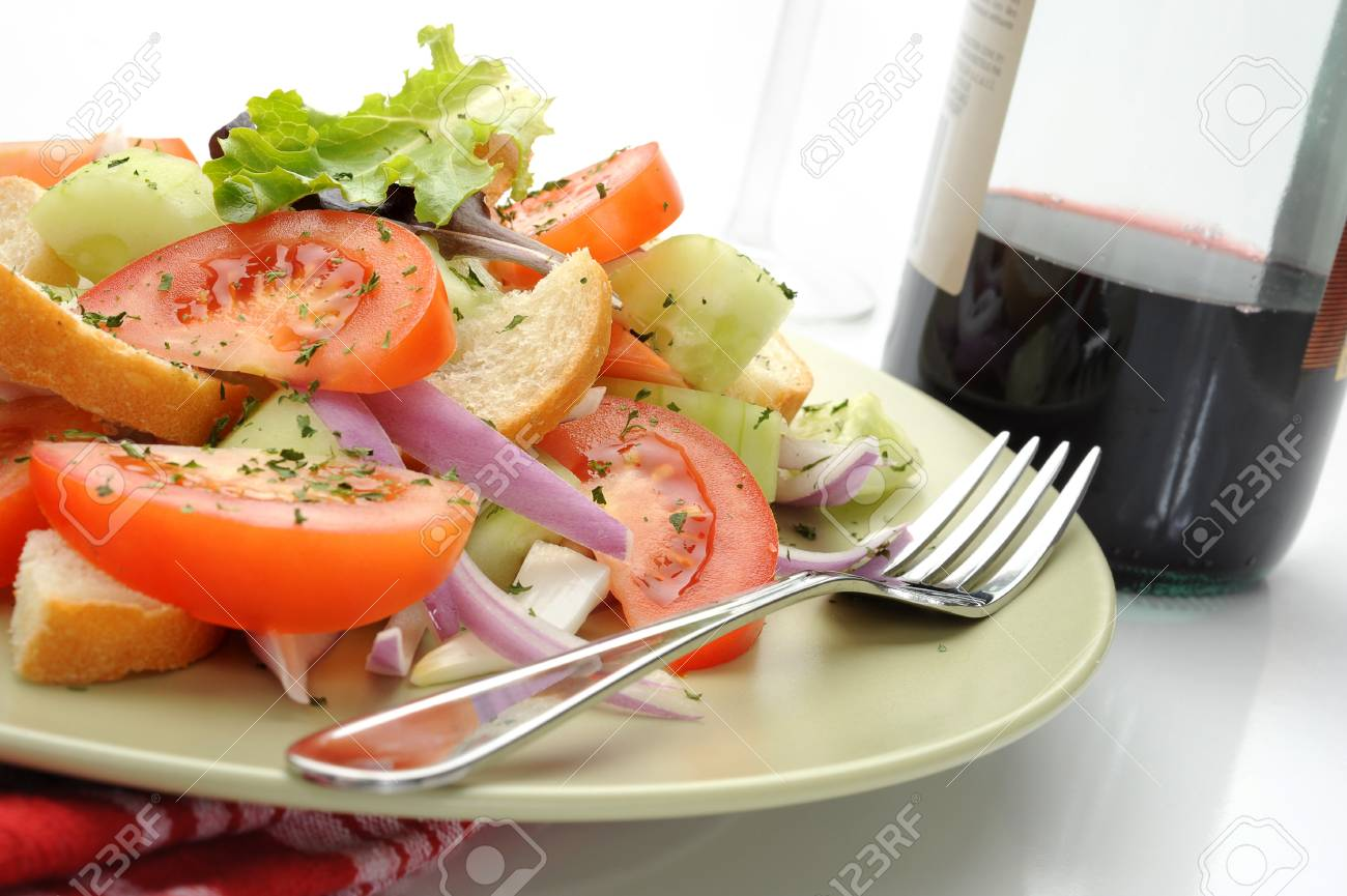 Extreme close-up image of salad with wine in background Stock Photo - 7448724