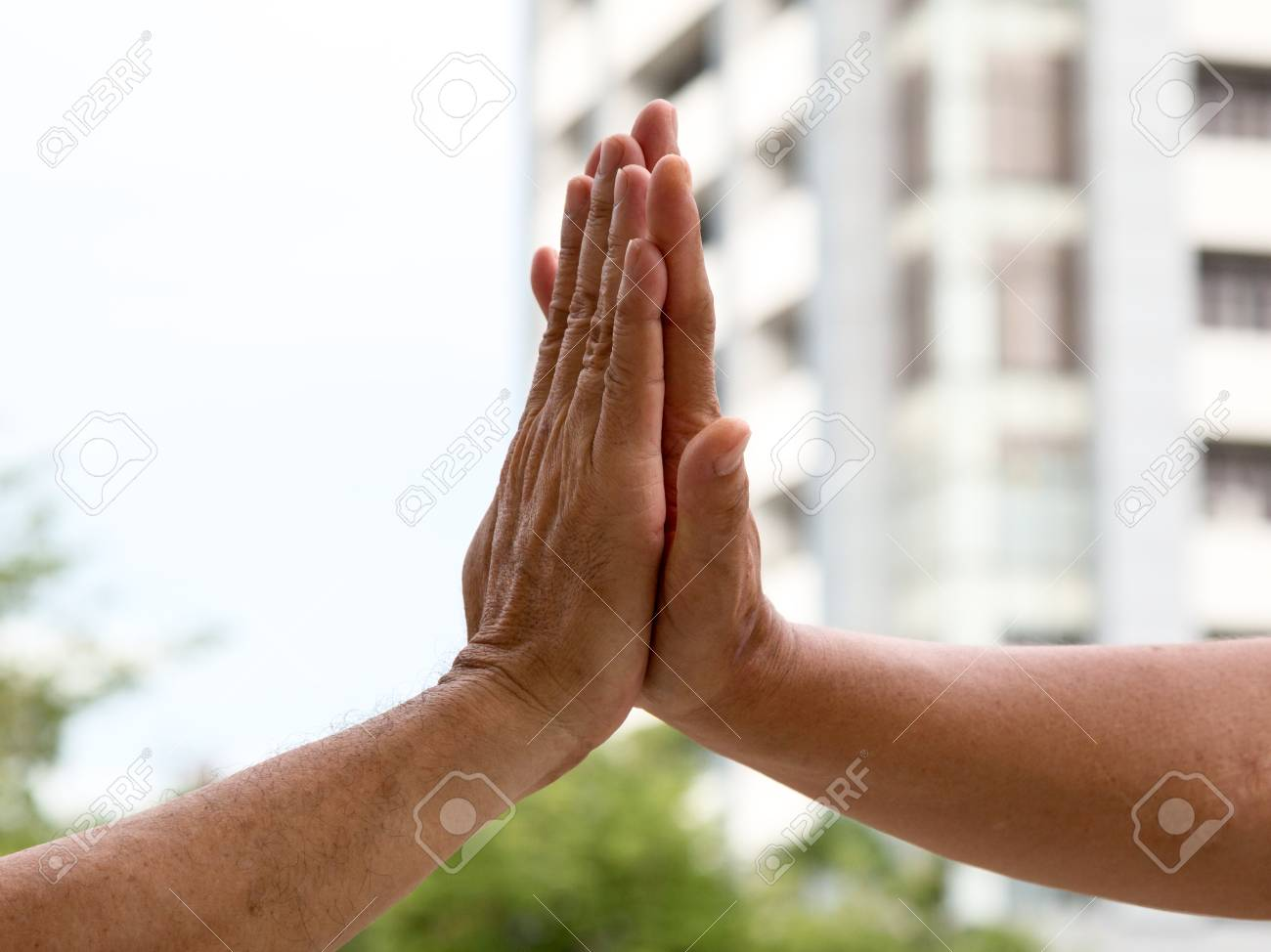 close up of hand clap of men giving hi five hand stock photo