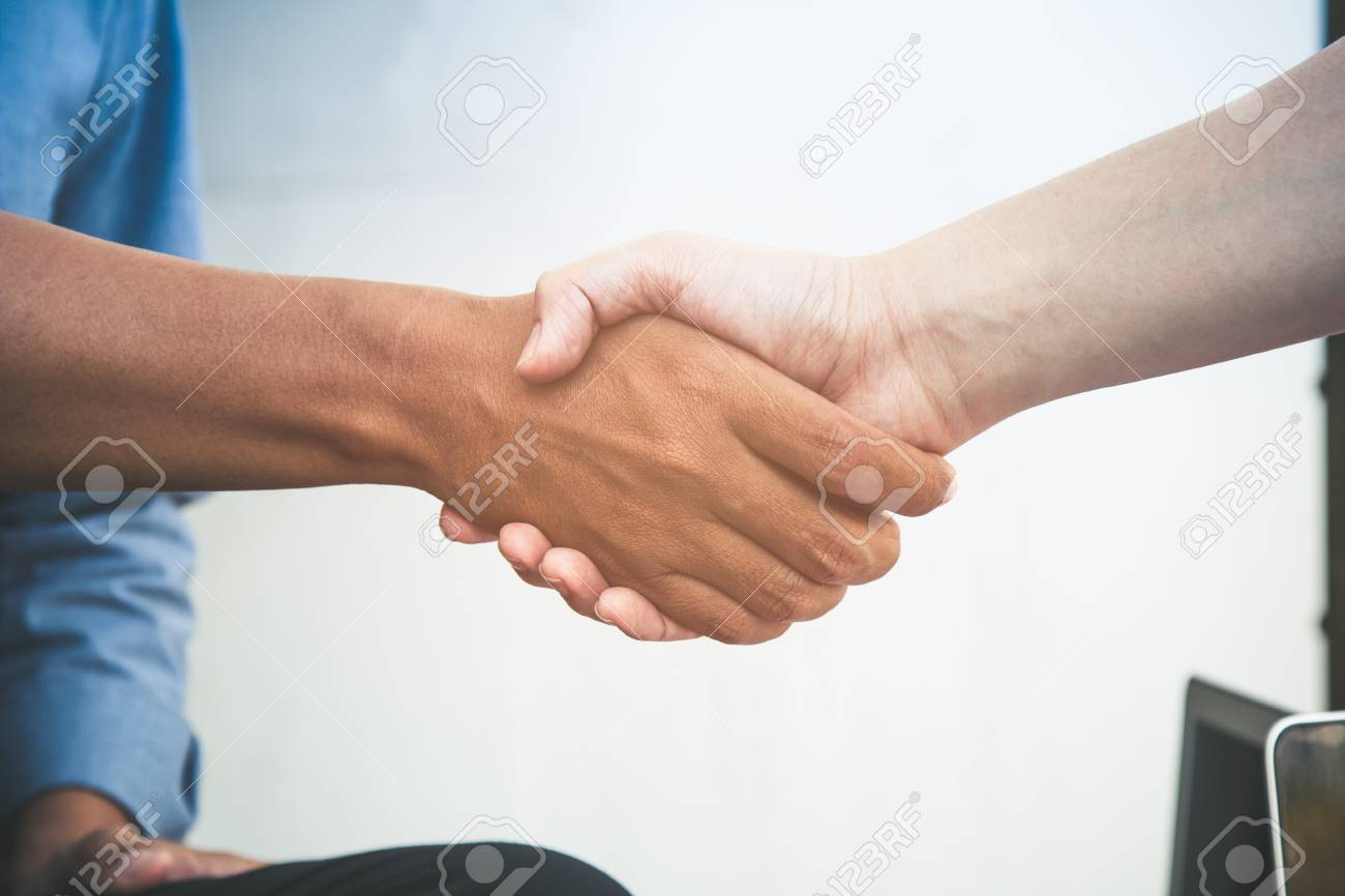 close up of two business man do hand shaking after acception the