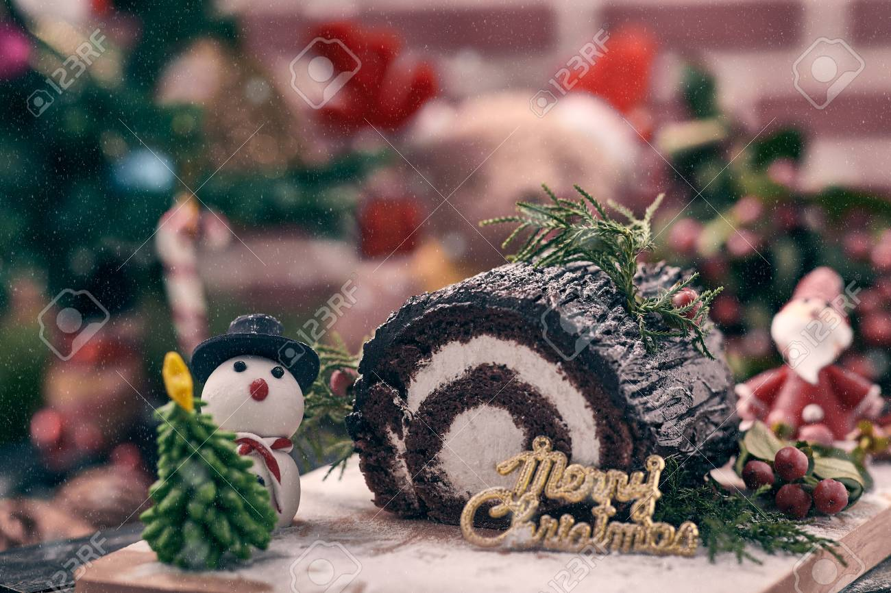 Christmas Chocolate Roll Cake Placing Together With Snow Man