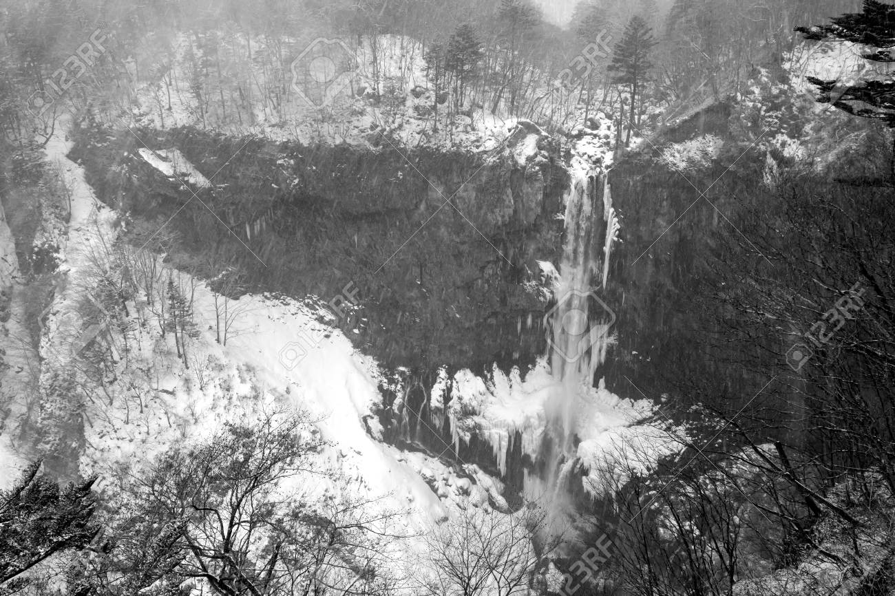 Kegon fall is frozen during strong snowfall in winter season