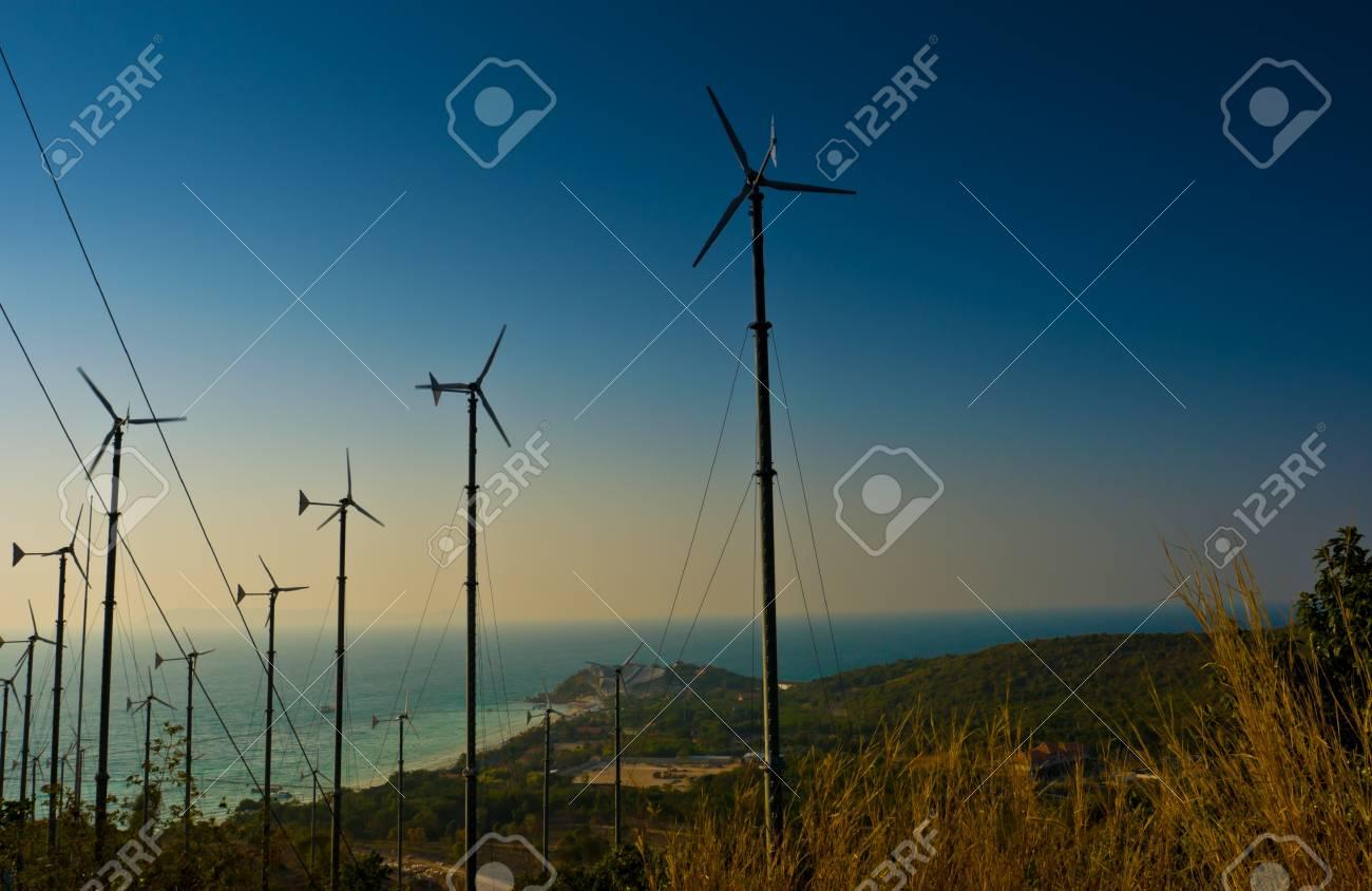 Wind turbines farm with a sunset,Pattaya Thailand Stock Photo - 8791537