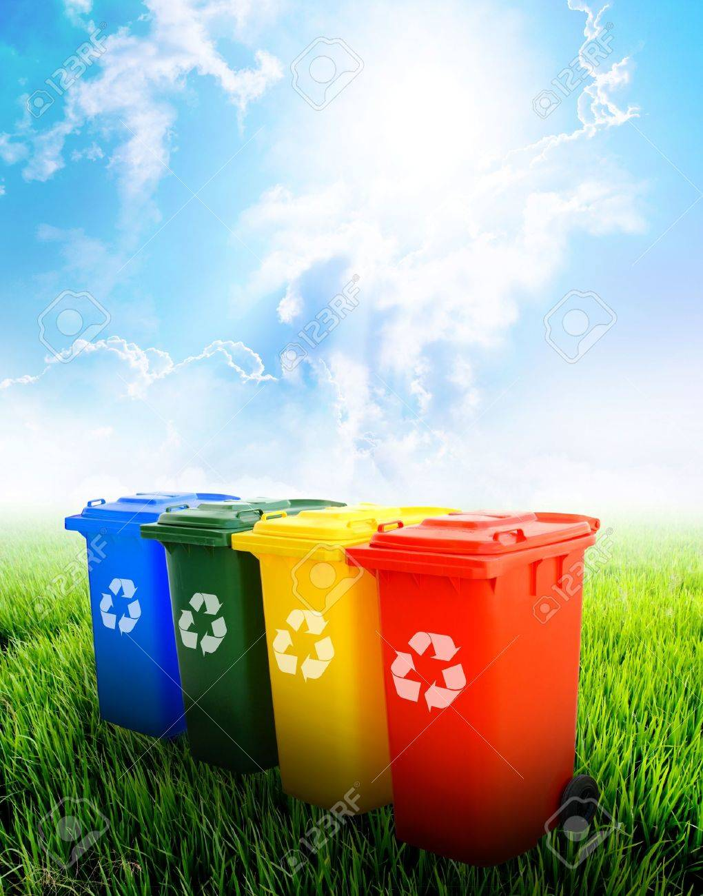 Colorful recycle bins ecology concept with landscape background. Stock Photo - 11065794