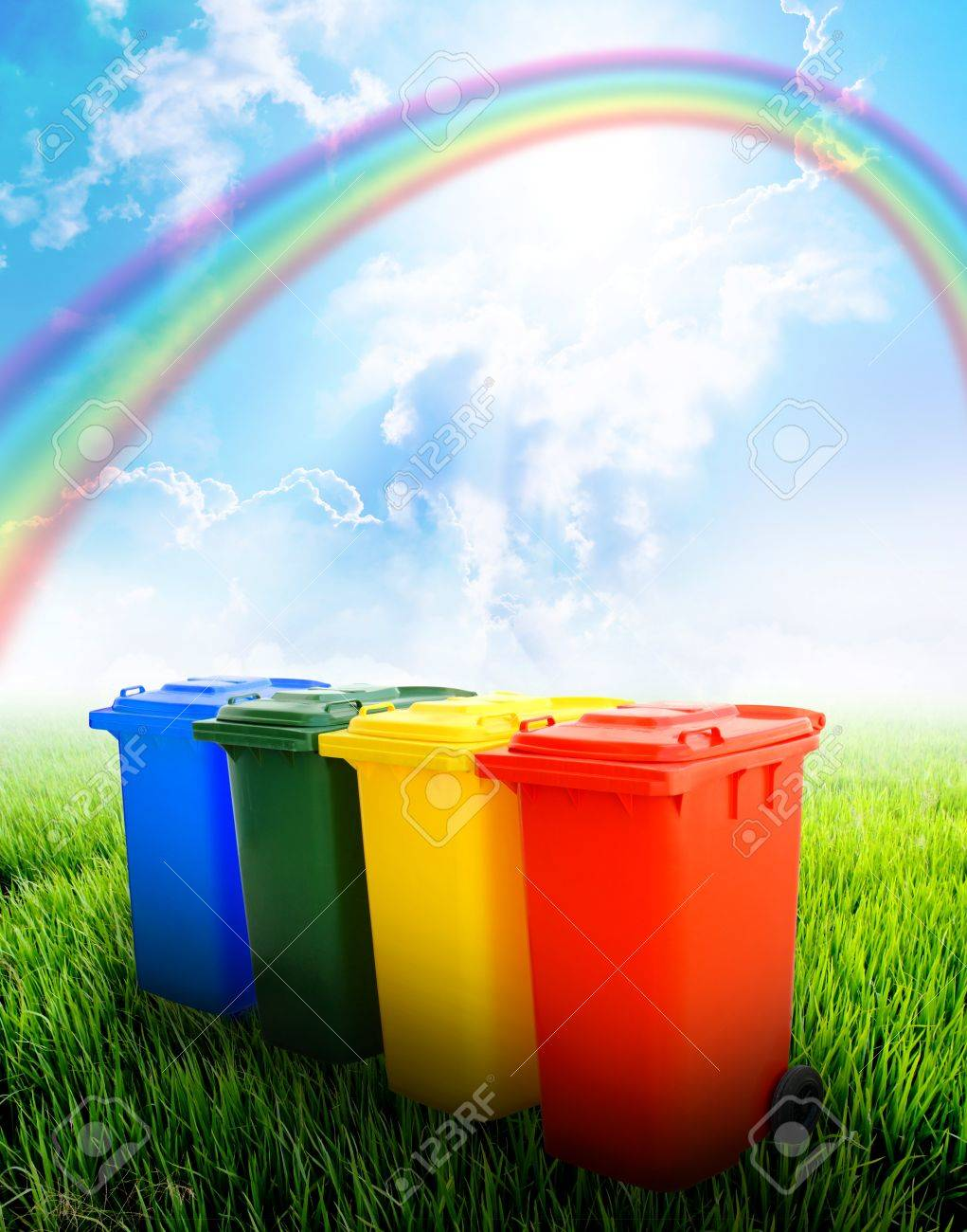 Colorful recycle bins  with landscape background Stock Photo - 12806450