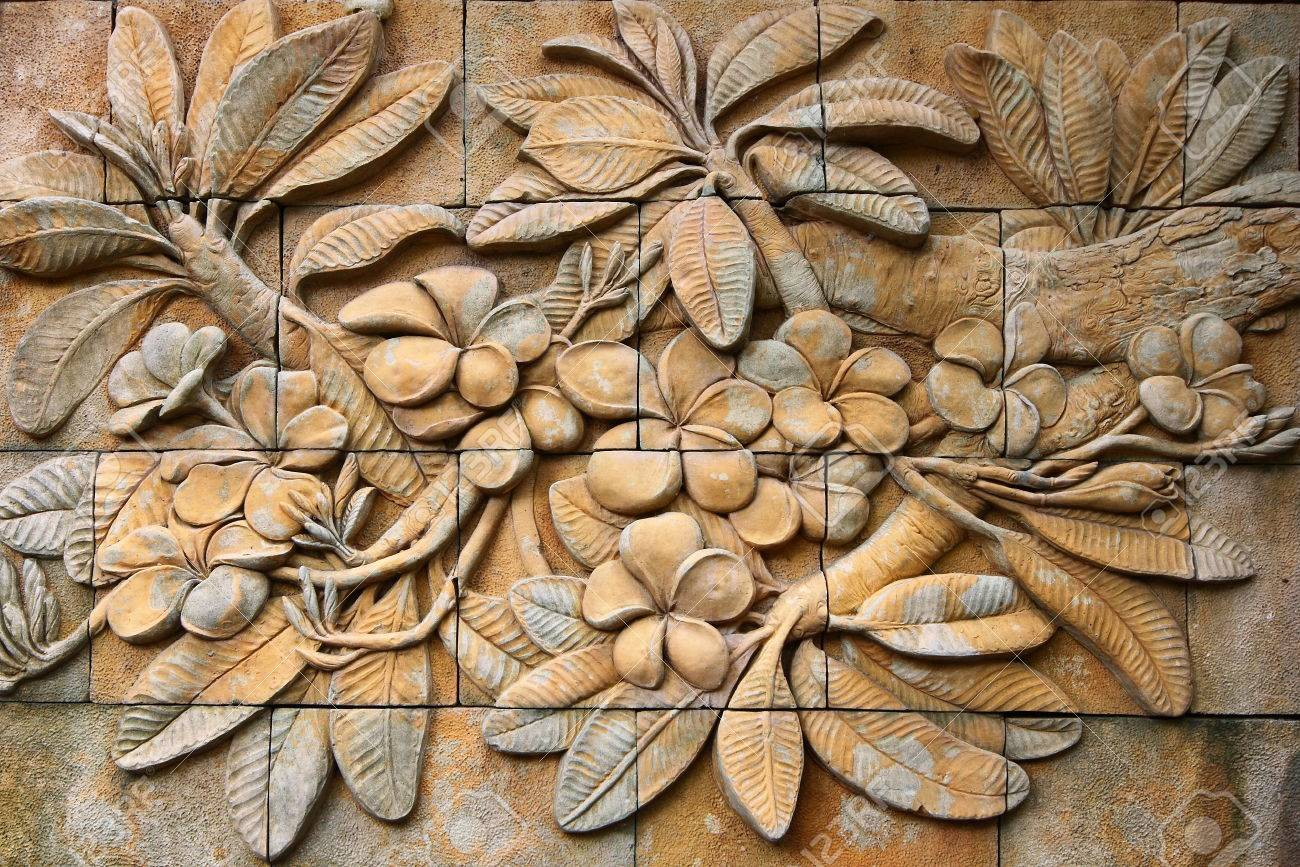 Low relief cement thai style handcraft of plumeria or frangipani