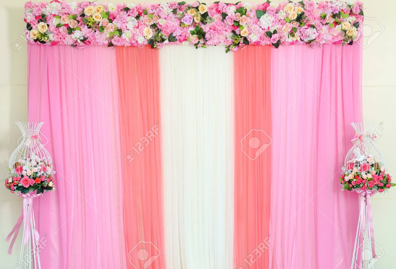 Colorful Backdrop Of Fake Flowers With Pink And White Fabric Stock