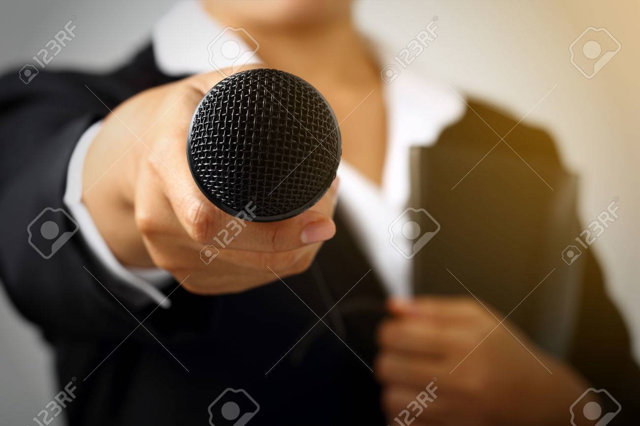 Businesswoman making speech with microphone and hand gesturing concept for explaining interview. - 68794062