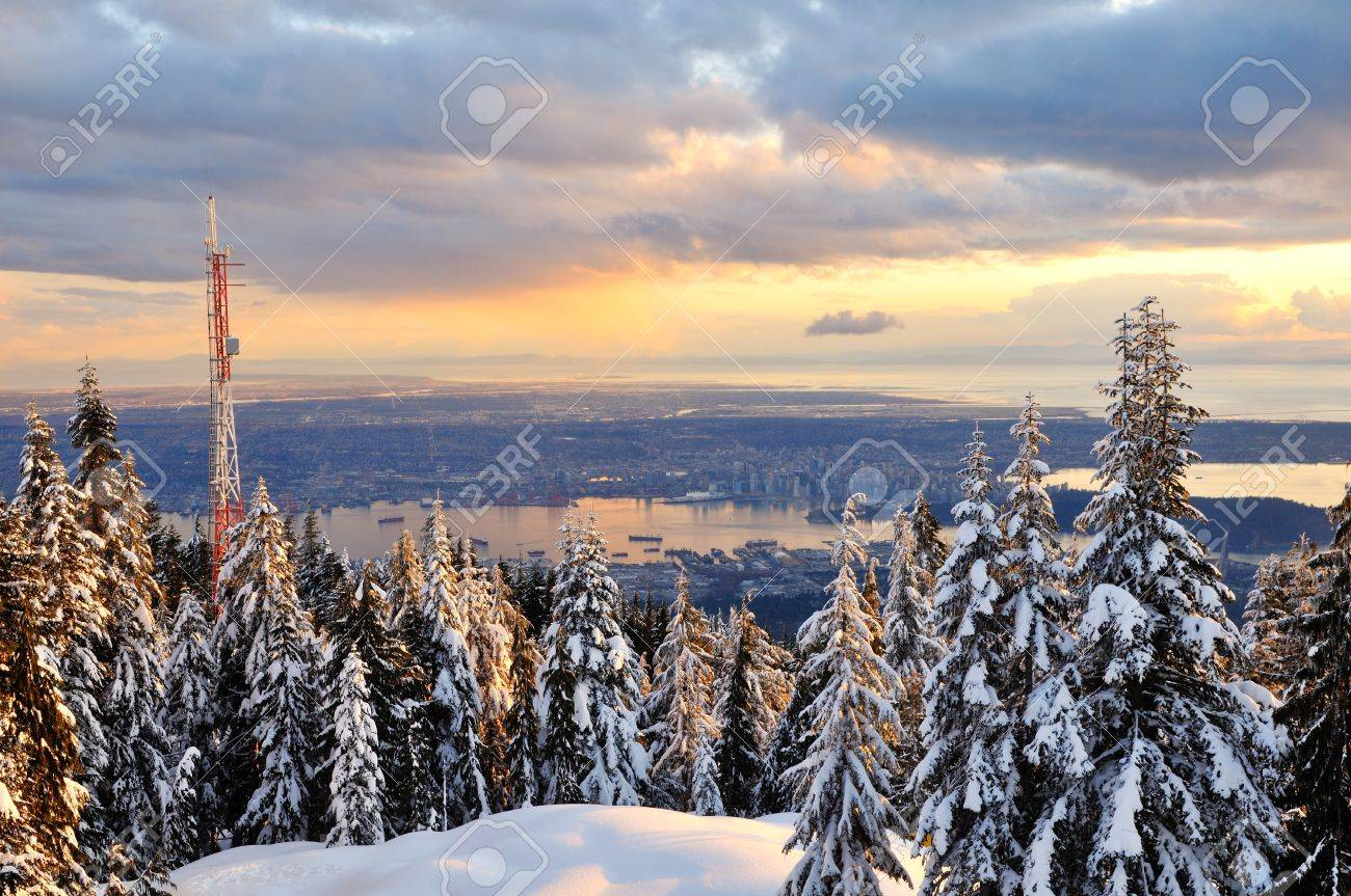 Grouse Mountain Winter Sunset With Downtown Vancouver In Background Stock Photo