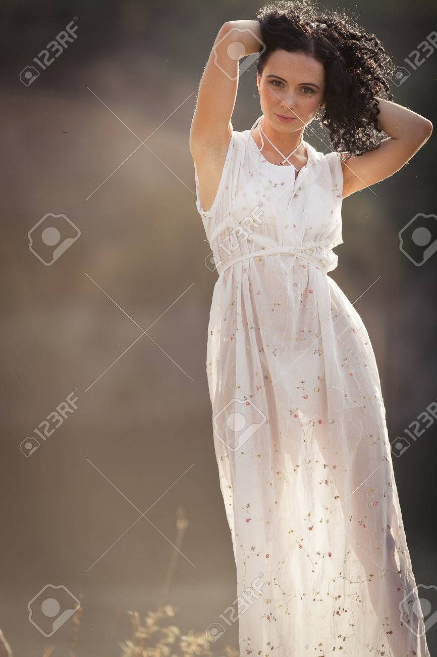 A Young Woman In A Transparent Dress On Vacation At A Mountain ...