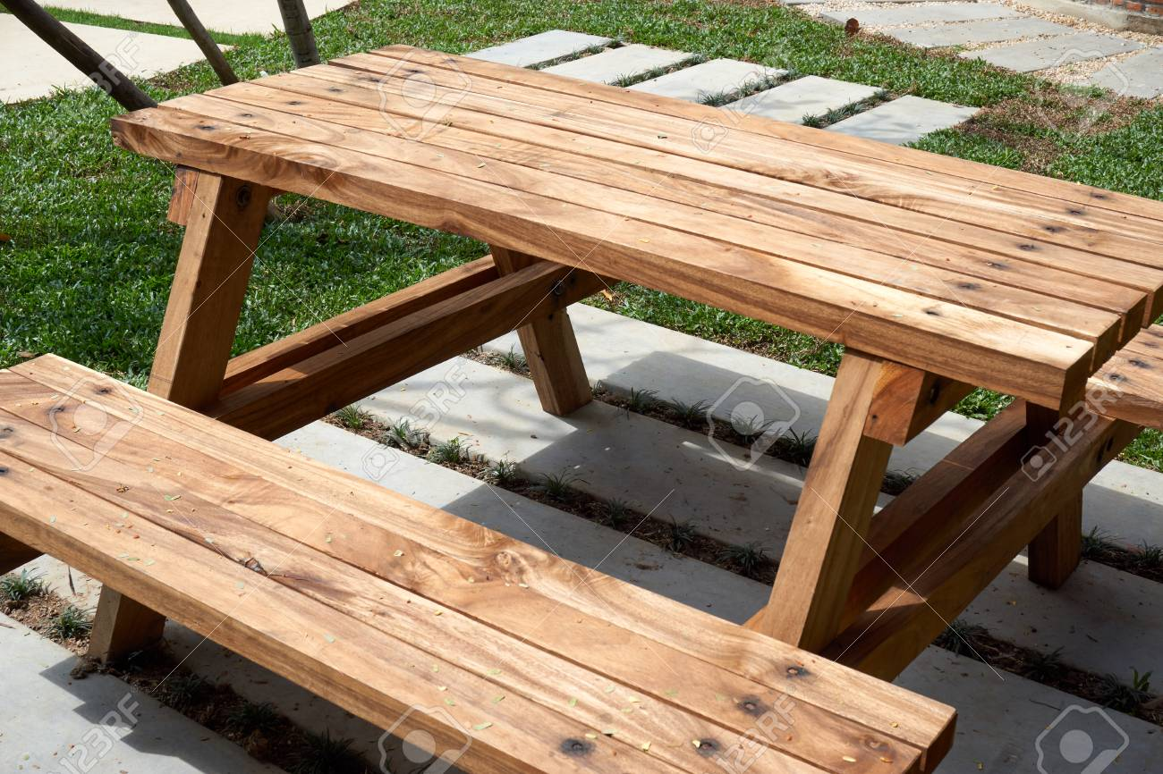 Wood table with bench place in garden