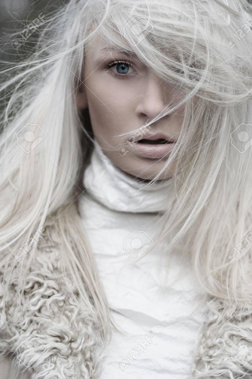 Portrait of a beautiful girl wearing white fur Stock Photo - 5899670