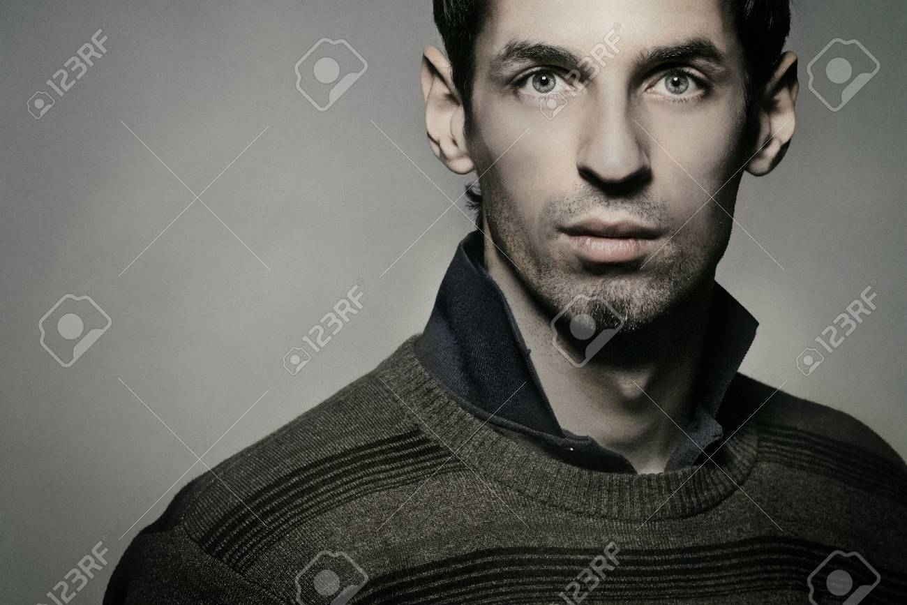 Attractive handsome young man, nostalgic , calm look. Stock Photo - 5899711