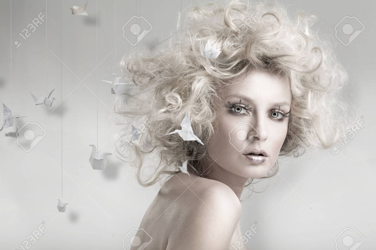 Attractive blond beauty with origami in the background Stock Photo - 5970057