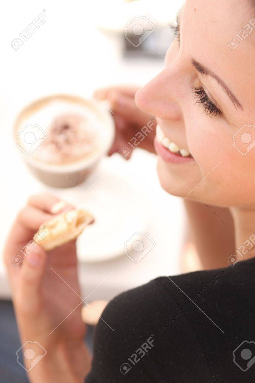 Young woman enjoying coffee break Stock Photo - 8504620