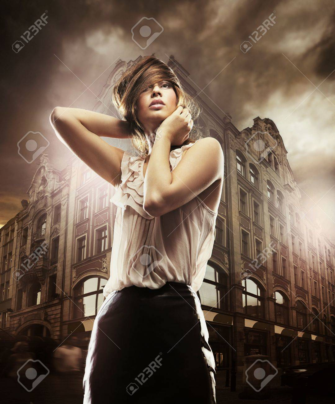 Fine art photo of a beautiful woman in front of a building Stock Photo - 8764568