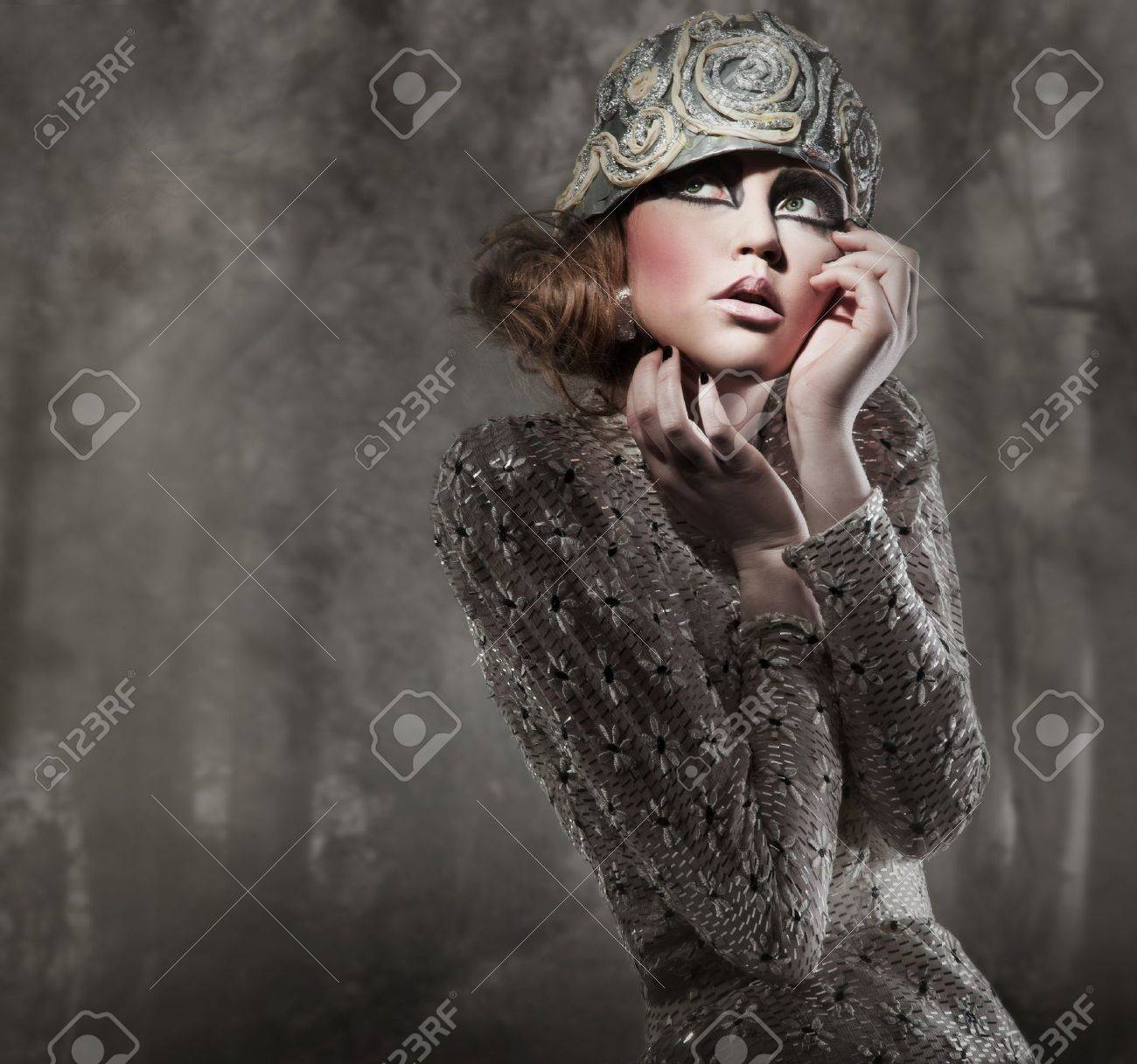 beautiful young lady in a mysterious gray forest Stock Photo - 8877852