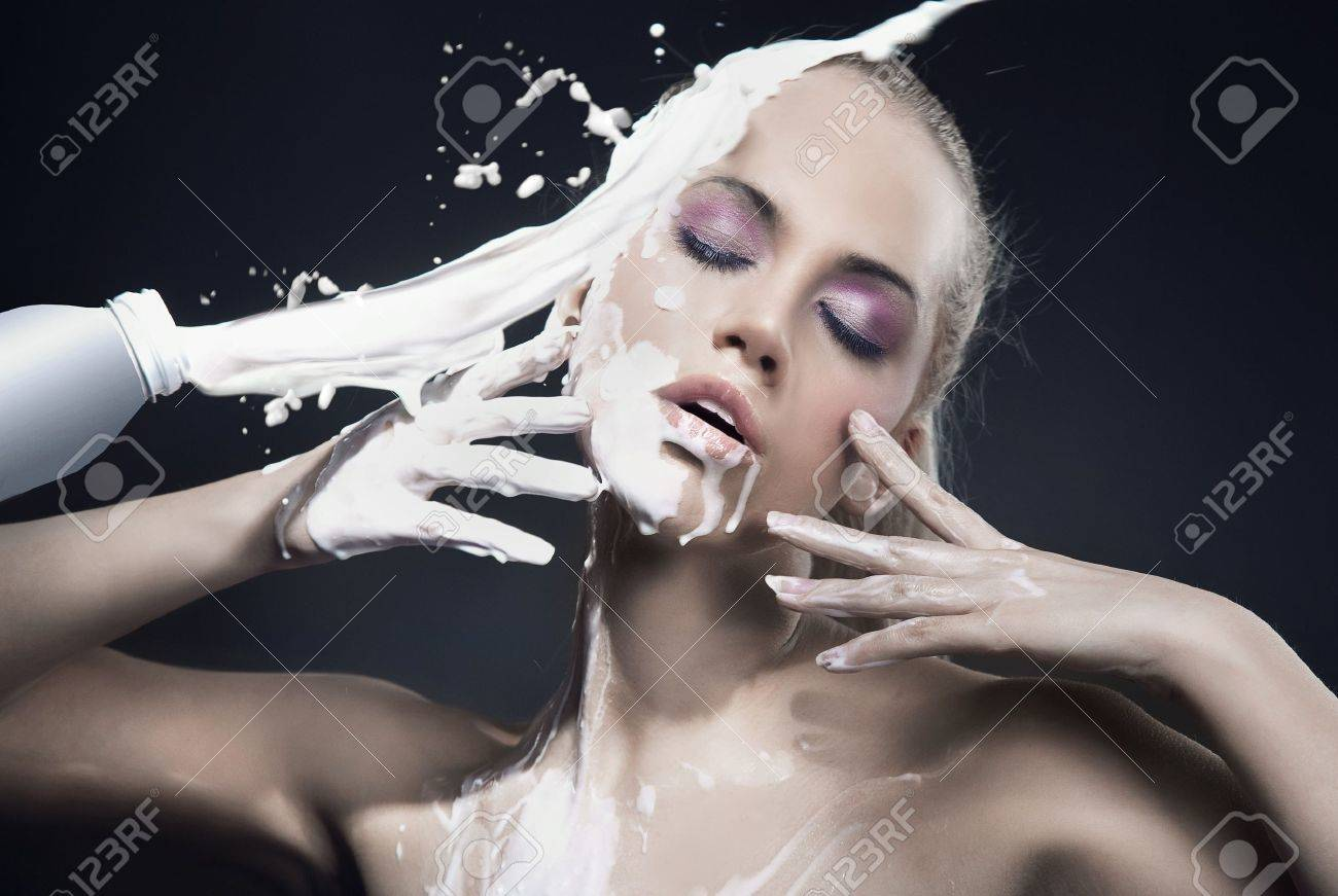 Portrait of a beautiful blonde dousing with cream Stock Photo - 8888377